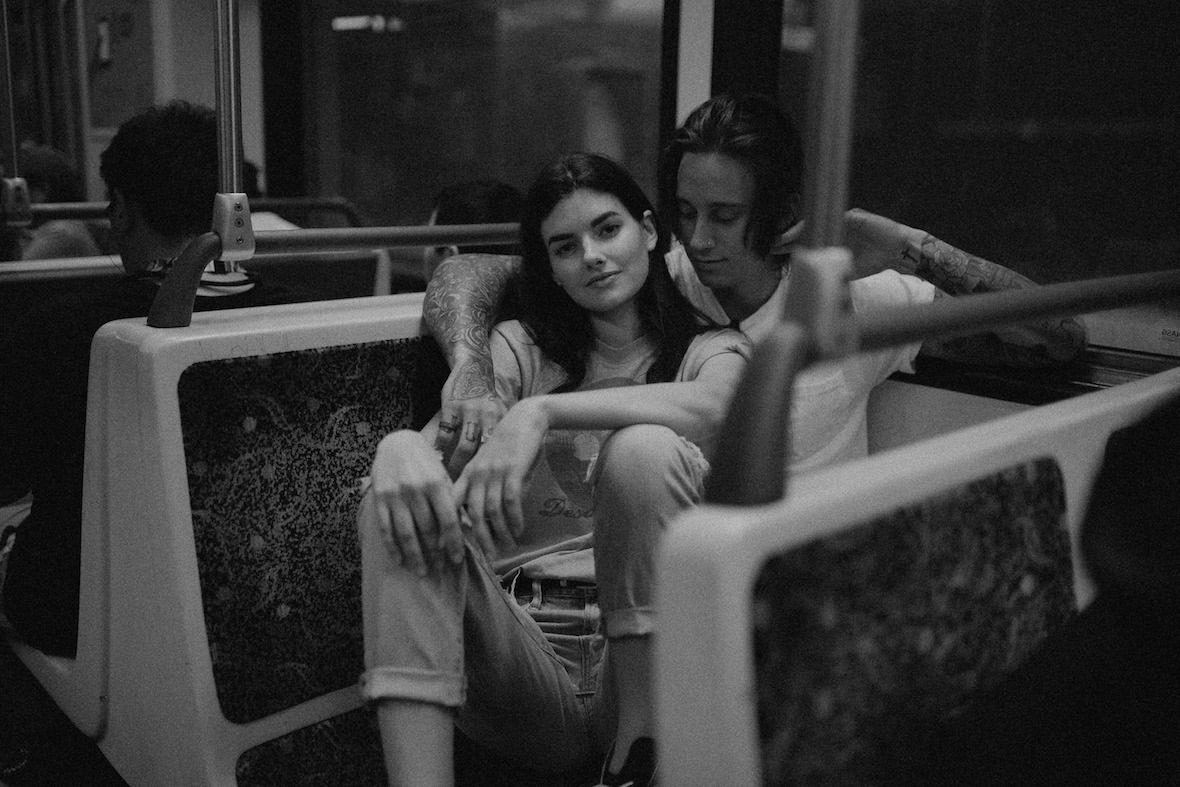 couple_together_on_subway_sitting.jpg