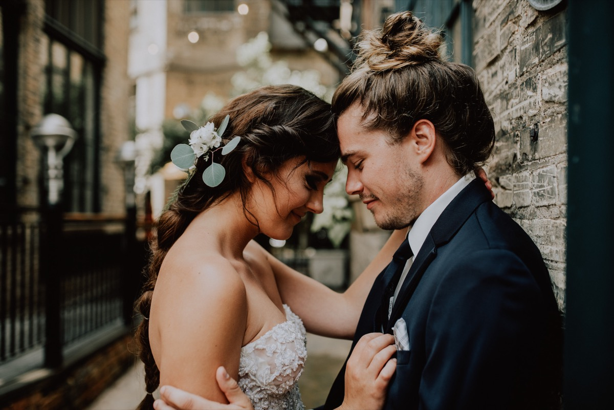 couple_touching_foreheads_wedding_day_brick_alley.jpg