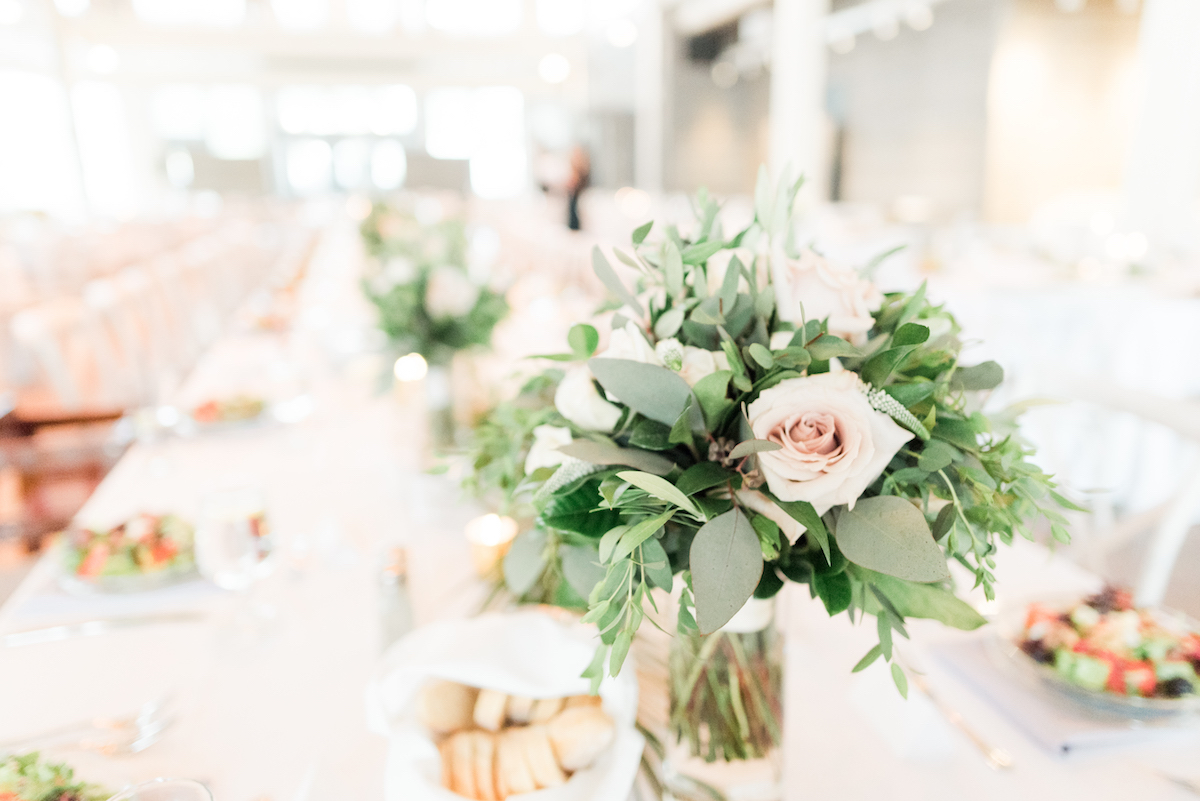 details_of_bright_indoor_venue_wedding_tables_floral_centerpieces.jpg