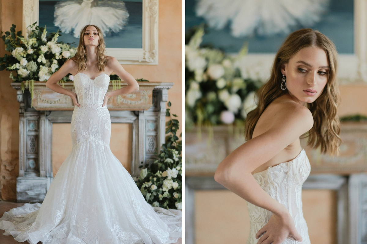 dramatic_french_bride_posing_in_lace_gown_rustic_building.jpg