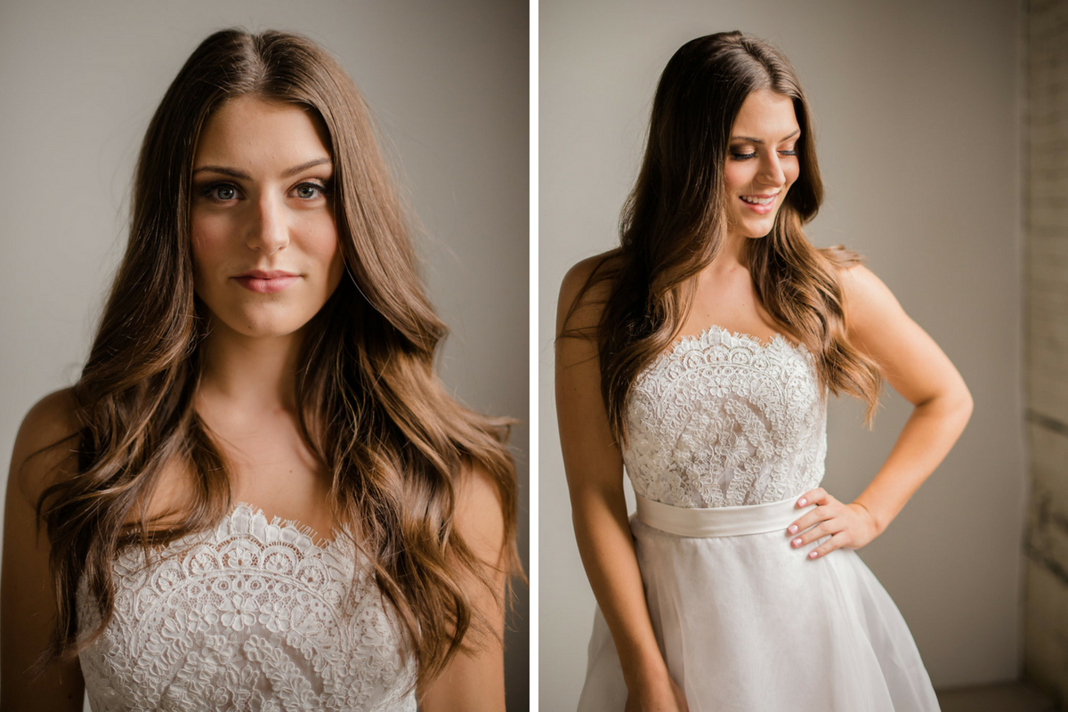 elegant_bride_smiling_with_lace_bridal_gown_warm_makeup.jpg