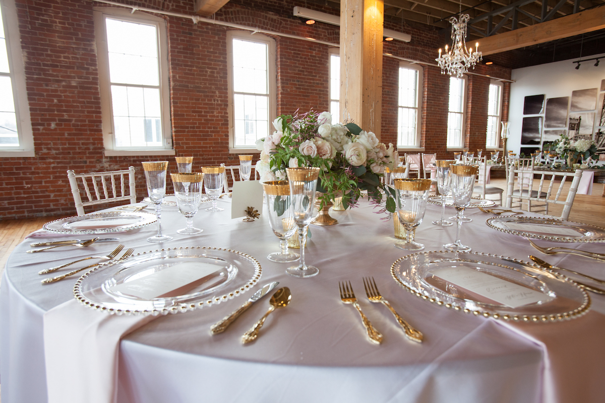 elegant_gold_and_pink_dinner_table_in_brick_reception_space.jpg