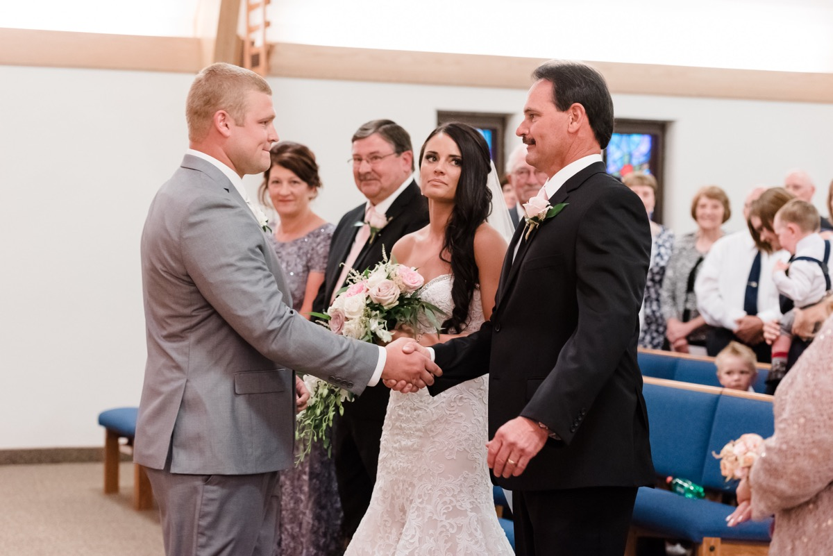 emotional_father_shaking_hands_with_groom_mankato_church_.jpg