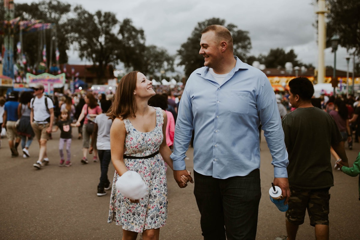 engaged_couple_mn_state_fair_holding_hands.jpg