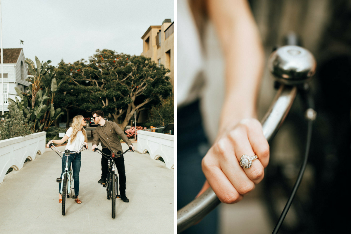 engaged_couple_on_white_walking_bridge_riding_bikes_leaning_to_kiss_and_engagement_ring_close_up.jpg