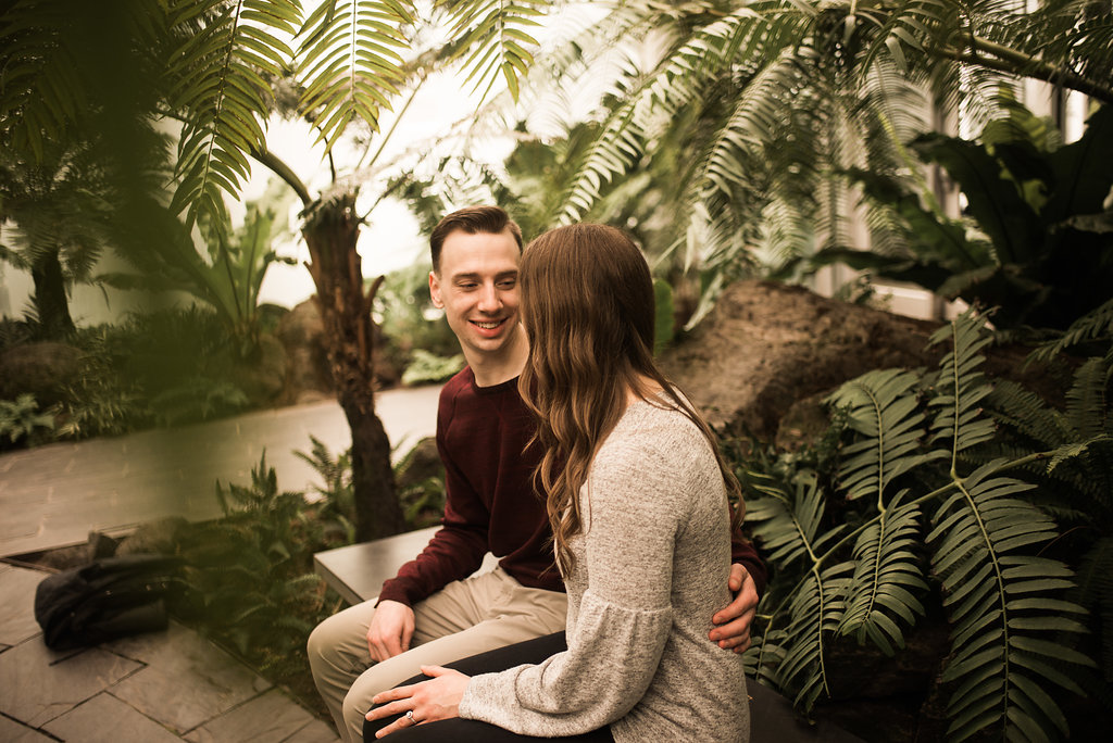 engaged_couple_sitting_indoor_garden_conservatory.JPG