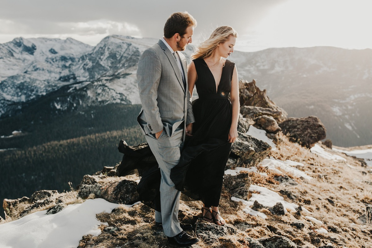 engaged_couple_standing_on_mountaintop_colorado.jpg