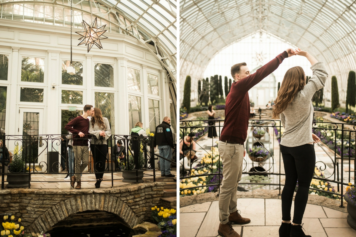 engaged_couple_twirling_kissing_in_indoor_garden_white_conservatory.jpg