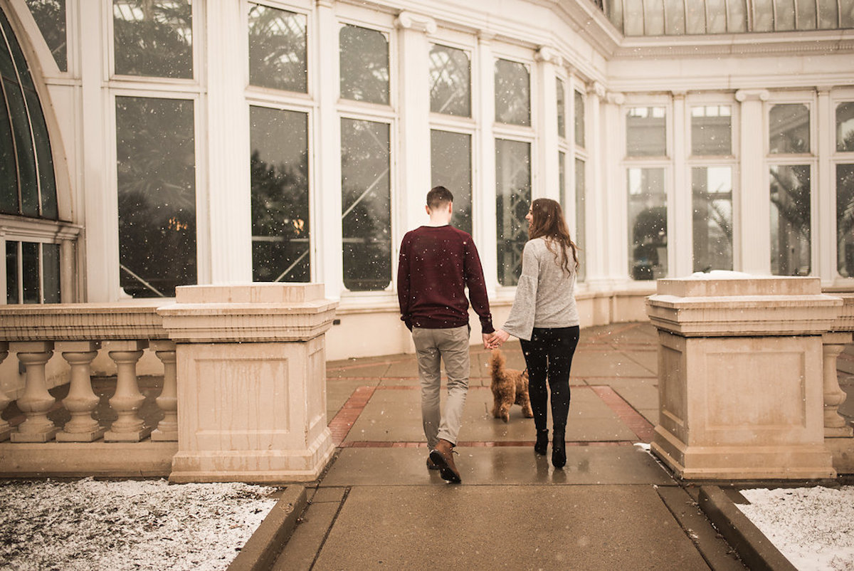 engaged_couple_walking_goldendoodle_white_conservatory.JPG