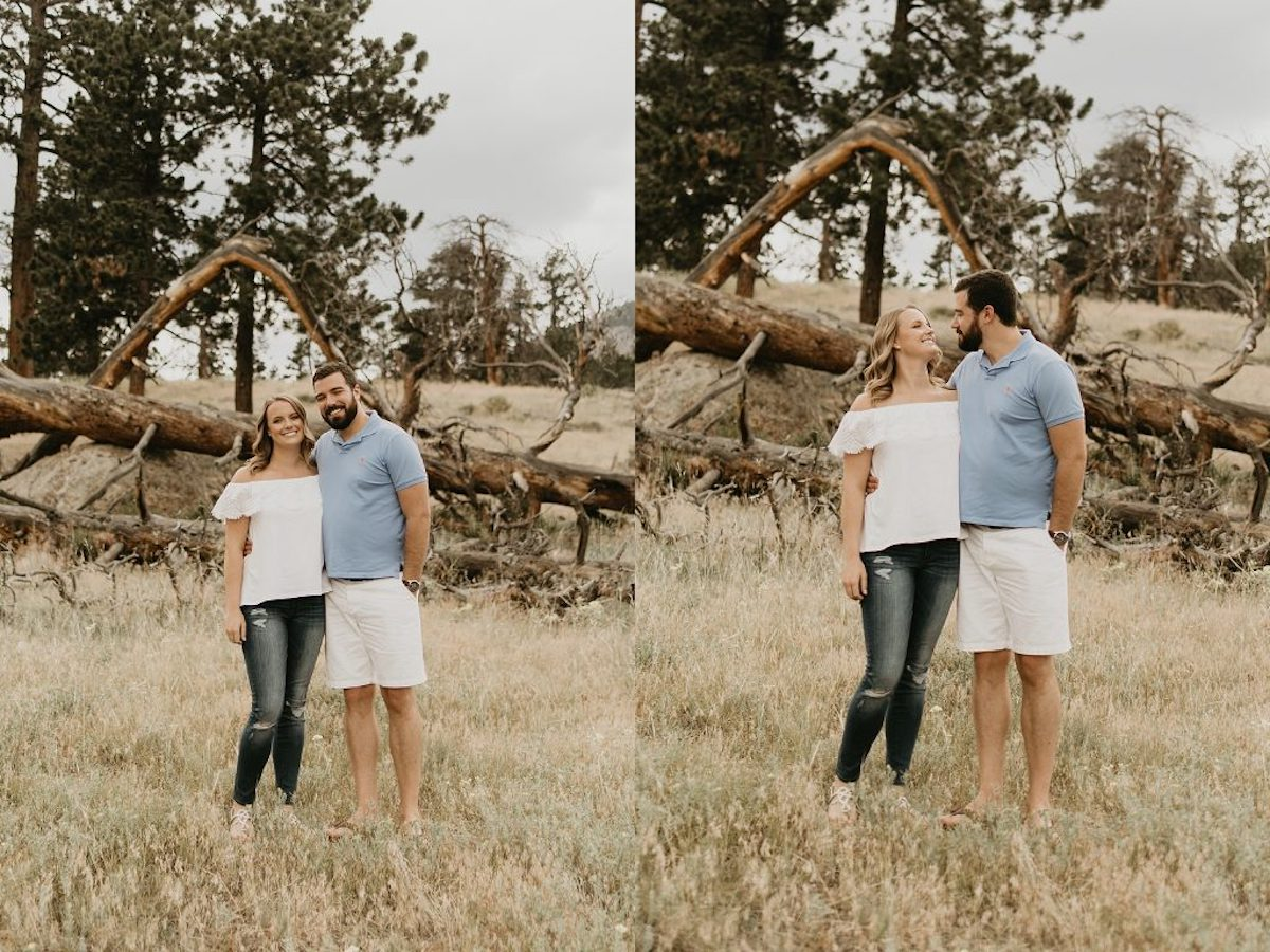 engagement_photo_couple_smiling_in_field_looking_at_camera_looking_at_each_other.jpg