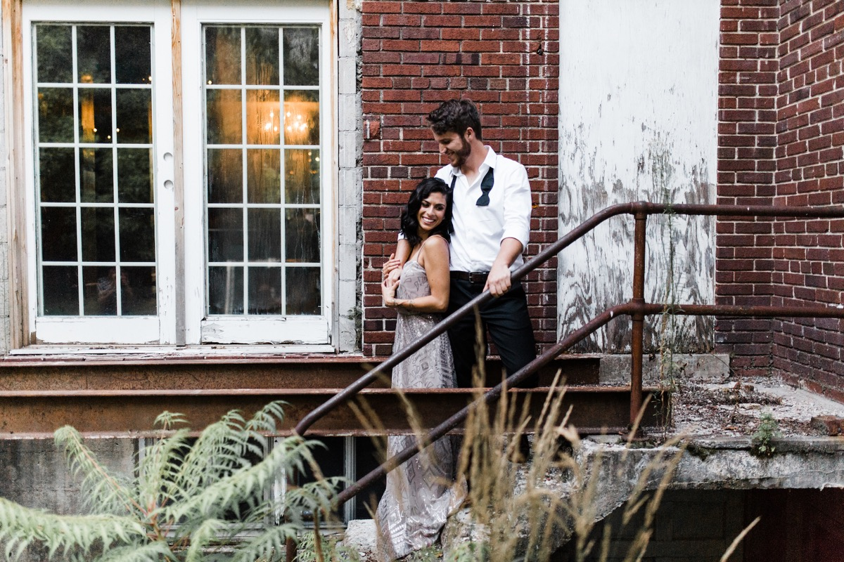 engagement_photos_against_red_brick_wall_mn.jpg