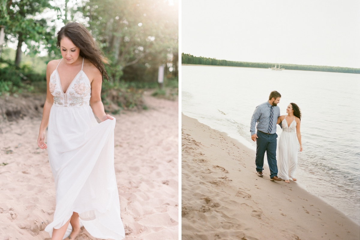 engagement_photos_couple_walking_on_beach_by_water_woman_wearing_white_dress.jpg