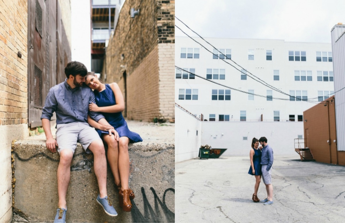 engagement_photos_couple_wearing_denim_outfits_brick_alleyway_white_building.jpg