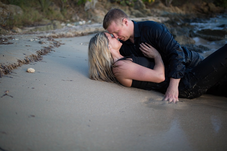 engagement_photos_laying_on_sand_almost_kissing.jpg