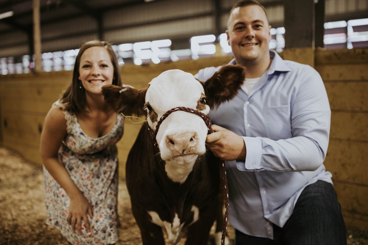 engagement_photos_posing_with_cow_state_fair.jpg
