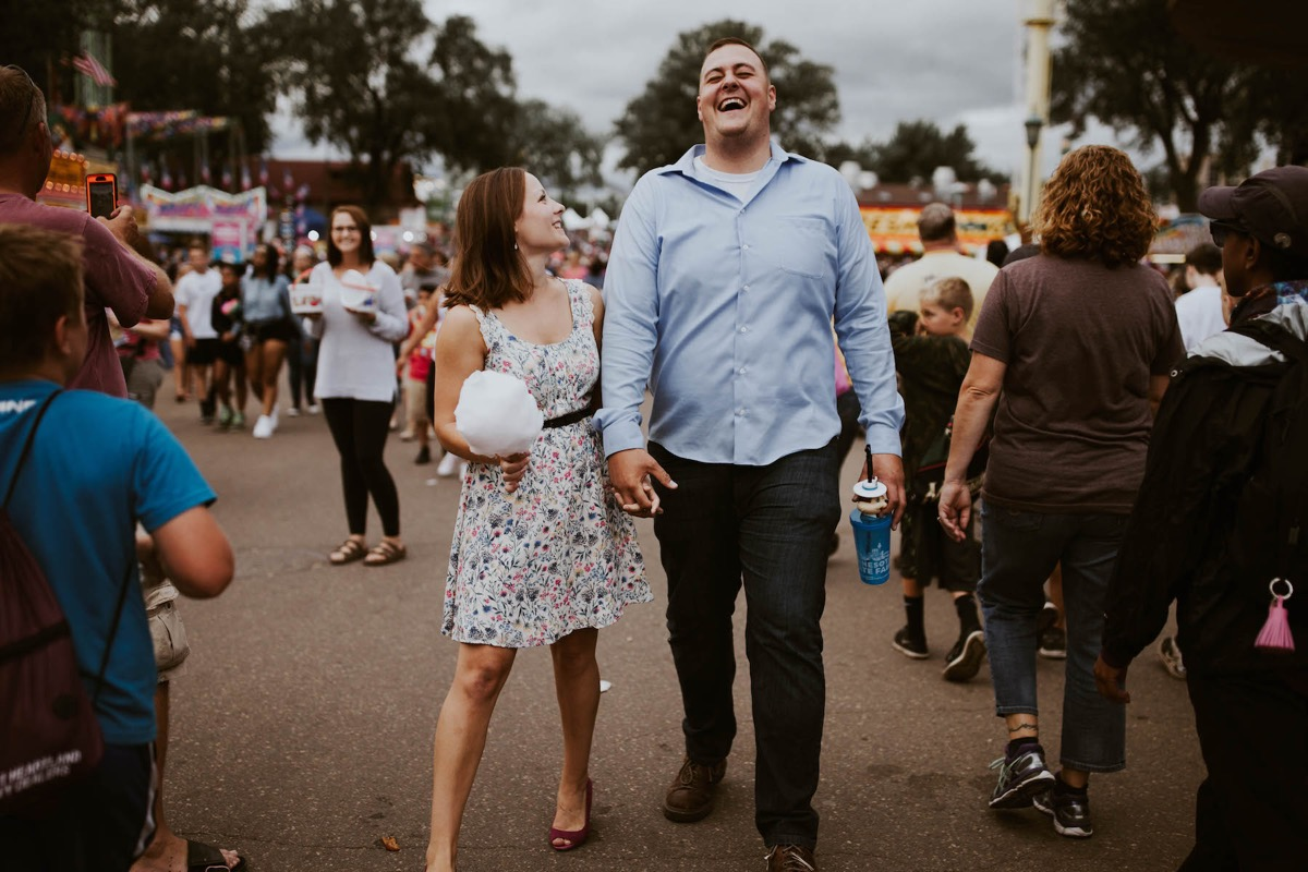 engagement_photos_state_fair_crowds_laughing.jpg
