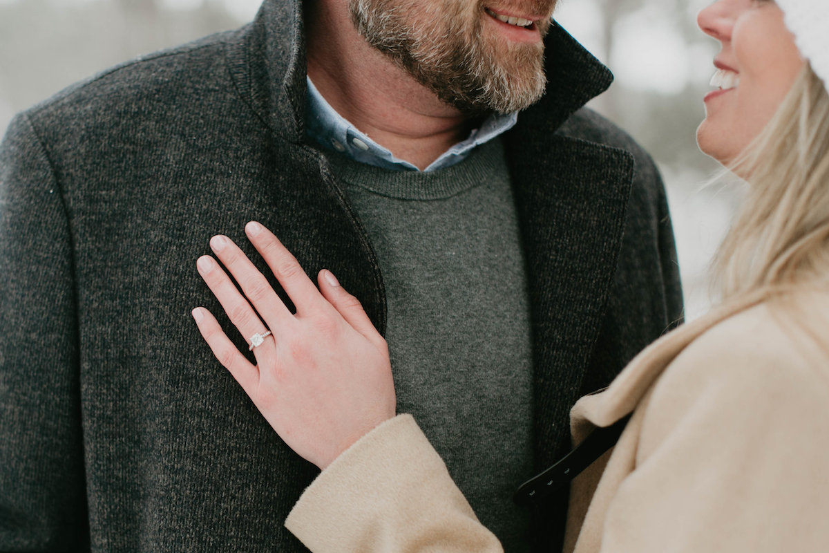 engagement_ring_close_up_winter_forest.jpg