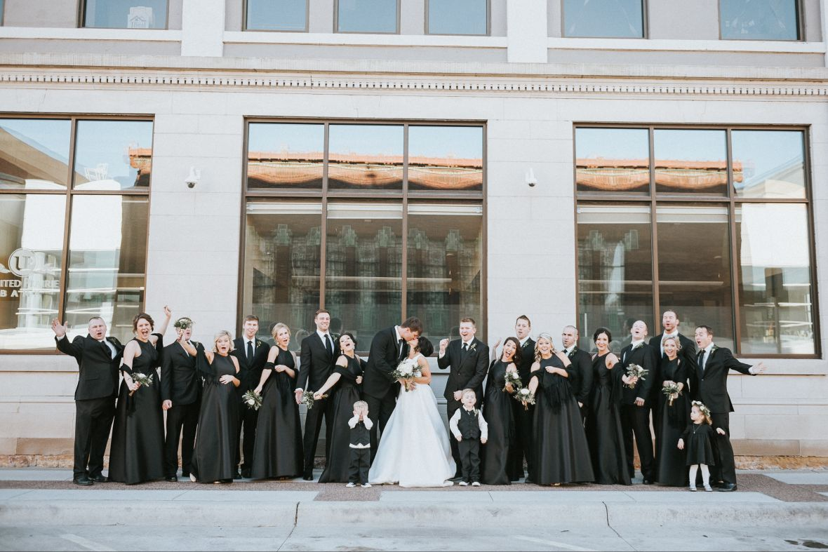 entire_wedding_party_front_of_windows_in_all_black.jpg