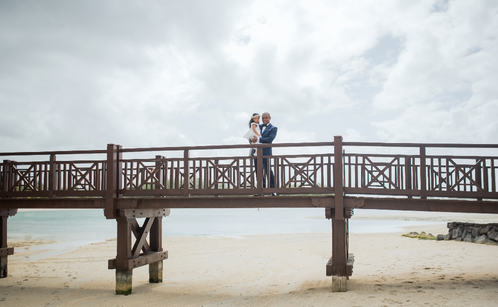 faraway_picture_groom_and_daughter_standing_on_dock.jpg