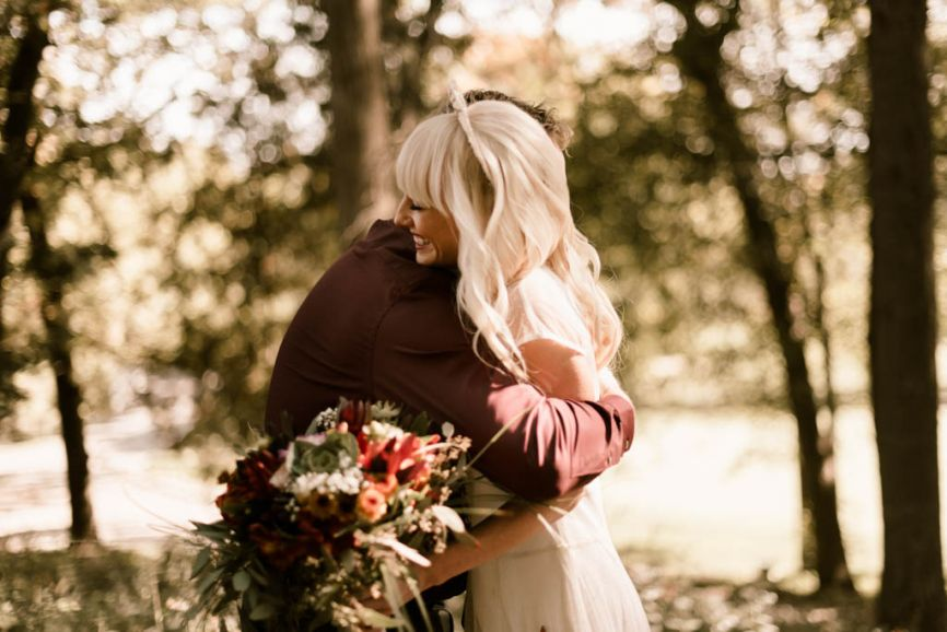 father_of_the_bride_hugging_daughter_fall_wedding_day.jpg