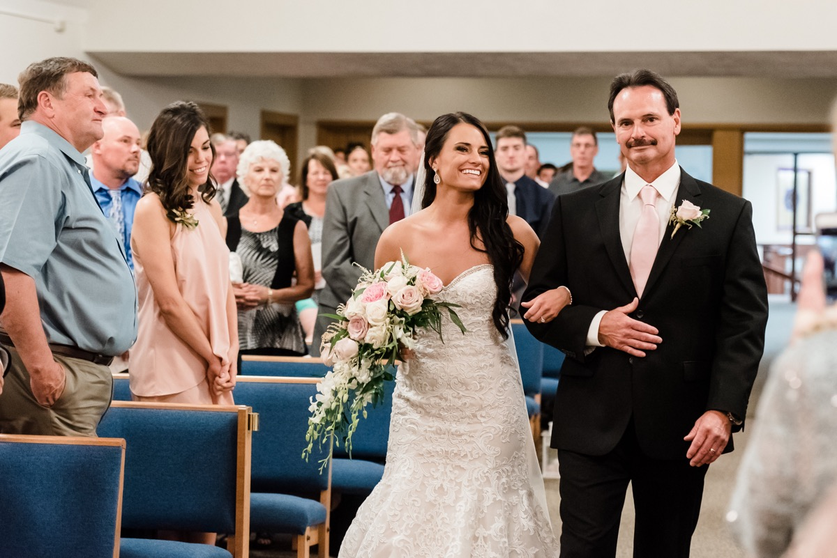 father_of_the_bride_walking_daughter_down_aisle_rochester_mn.jpg