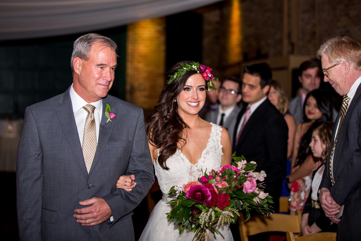 father_walking_bride_down_aisle_smiling_at_groom.jpg