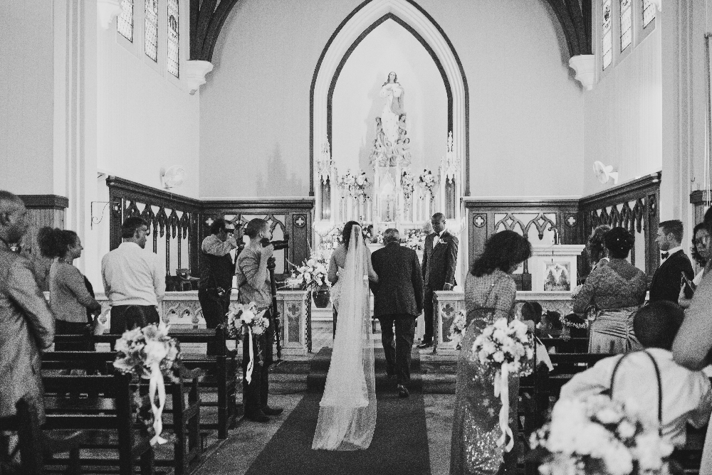 father_with_bride_at_altar_giving_away_to_groom.jpg