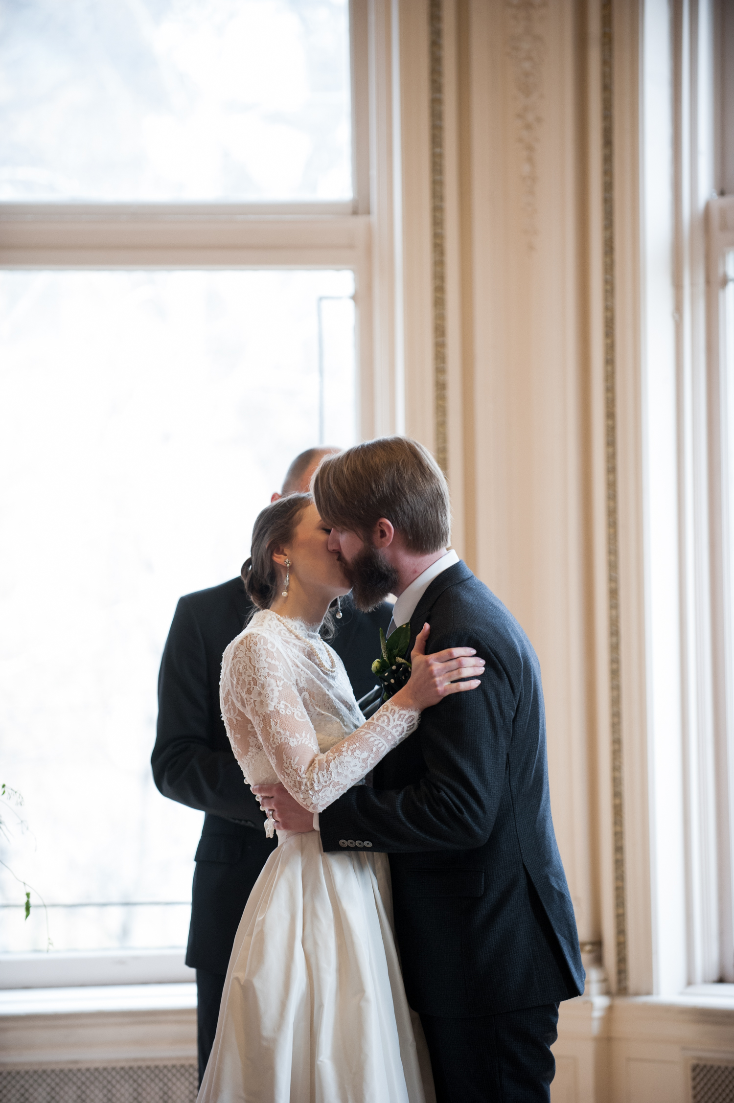 first_kiss_as_husband_and_wife_in_classy_vintage_wedding_minneapolis.jpeg