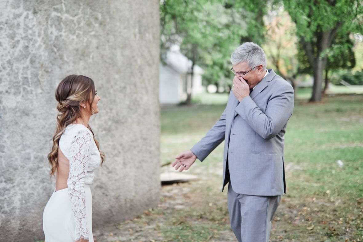 first_look_with_dad_on_wedding_day_emotional.jpg