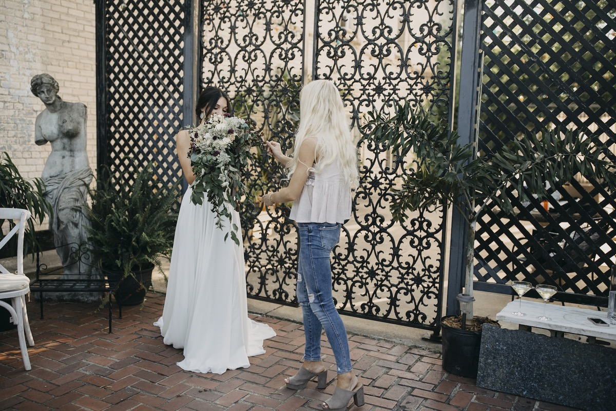 fixing_bridal_bouquet_with_bride.jpg