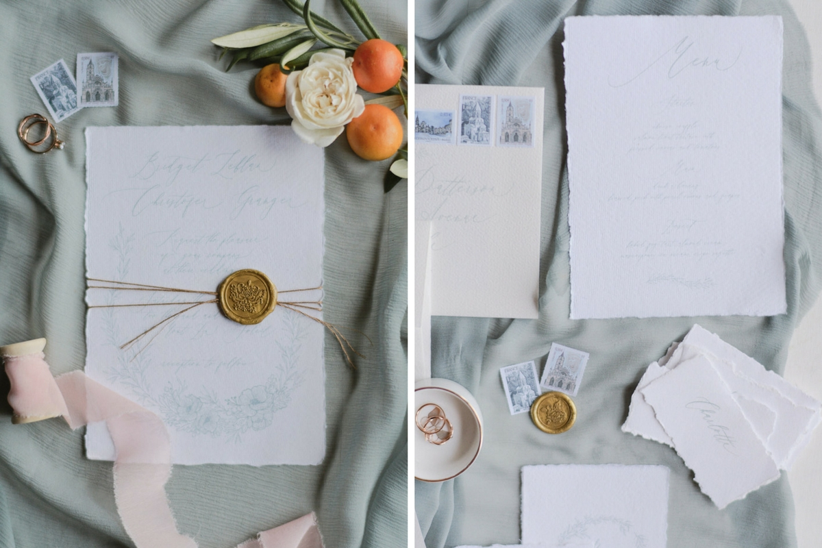 flatlay_of_french_style_wedding_invitations_with_gold_accents_oranges.jpg