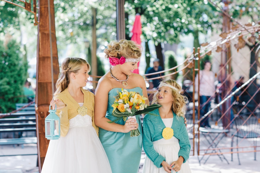 flower_girls_walking_with_bridesmaid_yellow_turquoise.jpg