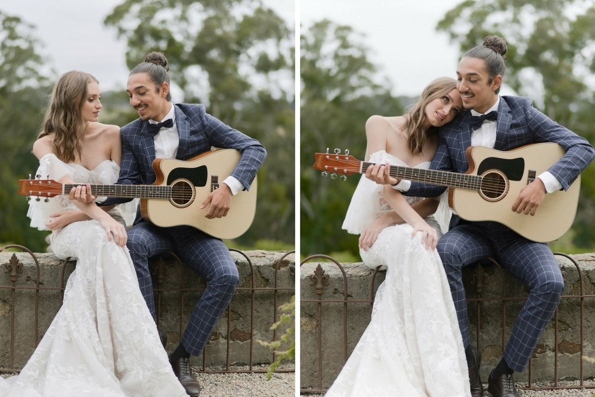 french_bride_and_groom_sitting_in_courtyard_groom_playing_guitar.jpg
