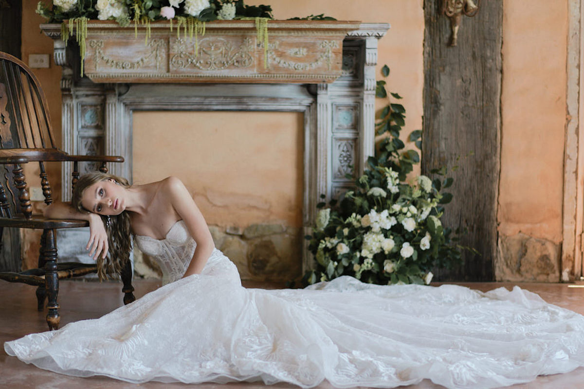french_bride_sitting_on_floor_leaning_on_chair.jpg