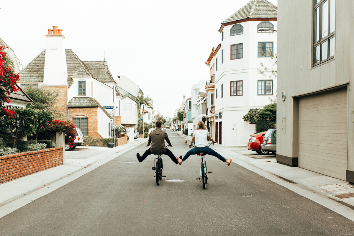 fun_couple_riding_bikes_down_street_marina_del_rey.JPG
