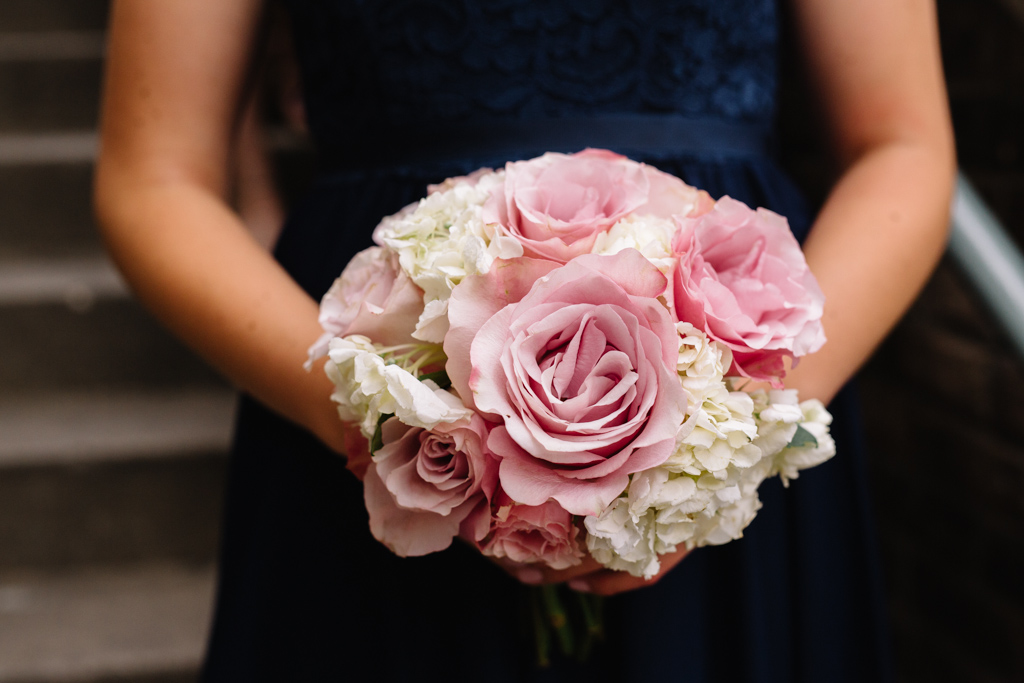 giant_pink_roses_white_flower_bouquet_navy_bridesmaid_dress.jpg