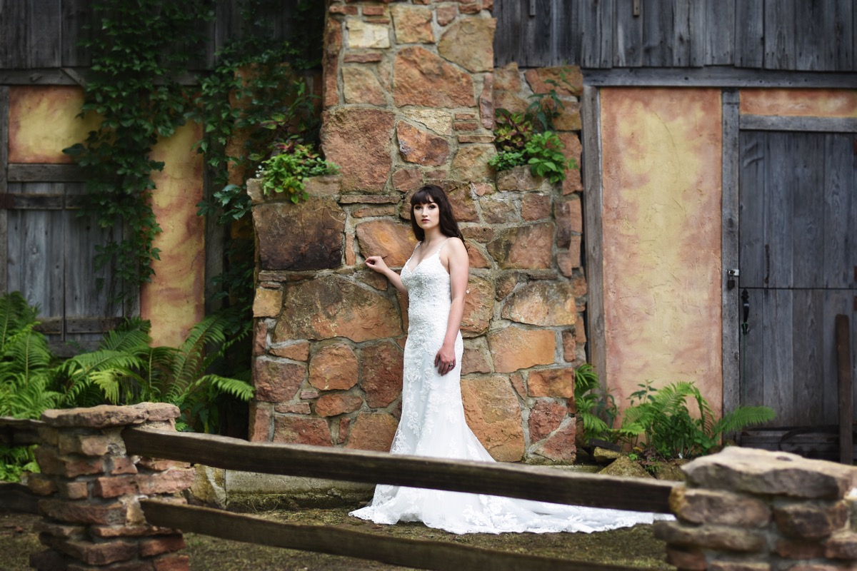 glamour_bride_posing_by_bricks_renaissance_fair.jpg