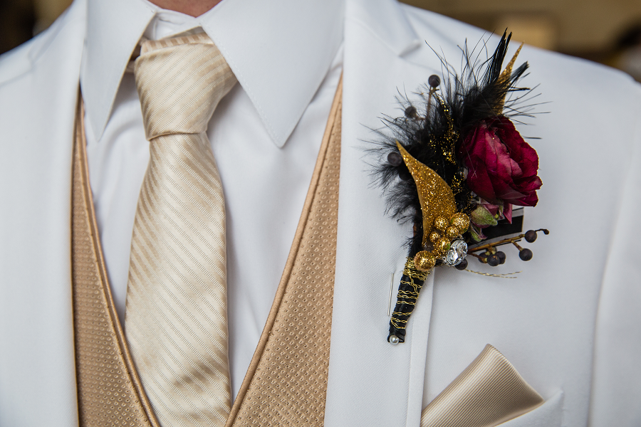 gold_glittery_boutineer_white_tux_taupe_vest.png