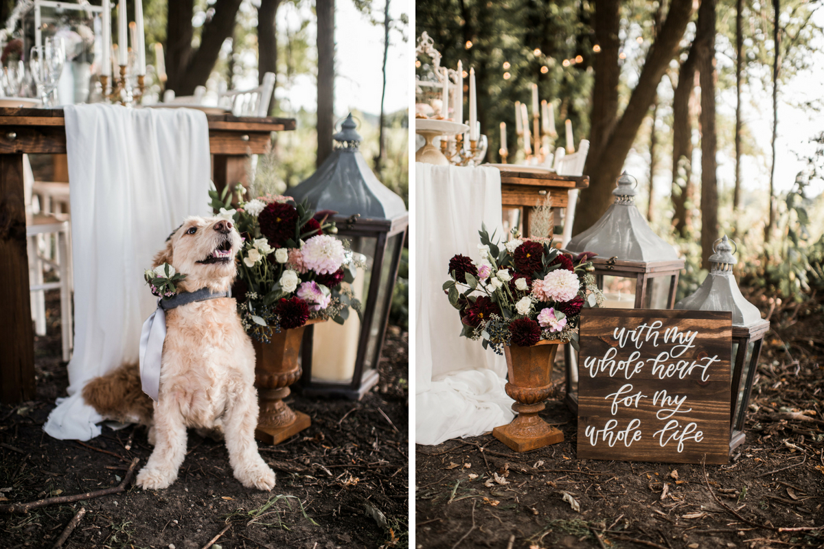 golden_doodle_puppy_standing_by_wedding_dinner_table_wood_sign_romantic.jpg