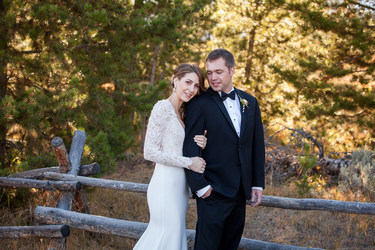 golden_hour_newlywed_portait_colorado_forest_bride_leaning_grooms_shoulder.jpg