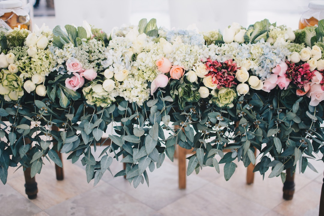 grand_amounts_of_flowers_at_wedding.jpg