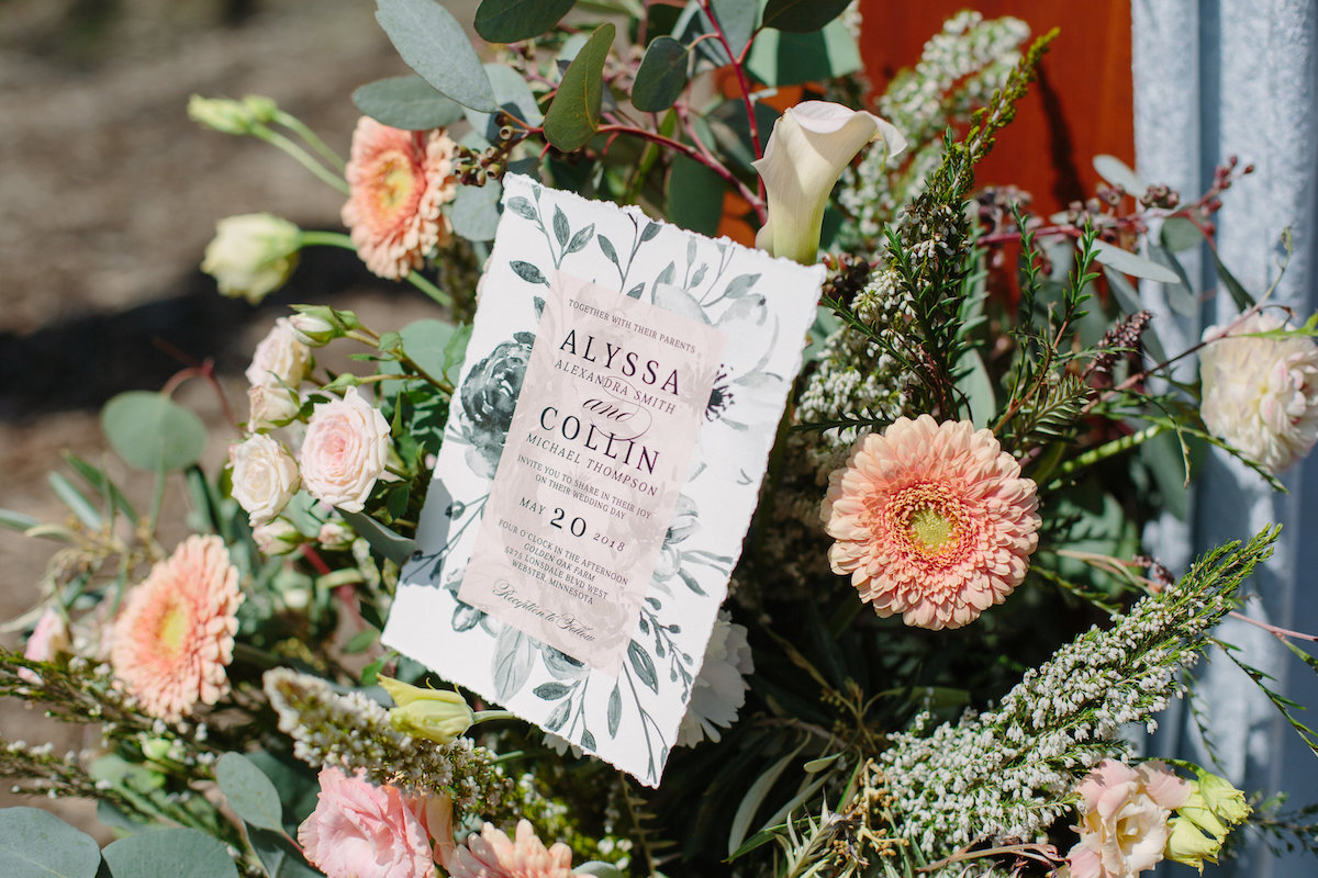 green_grey_floral_wedding_invitation_set_in_floral_bouquet_light_pink_flowers.jpg