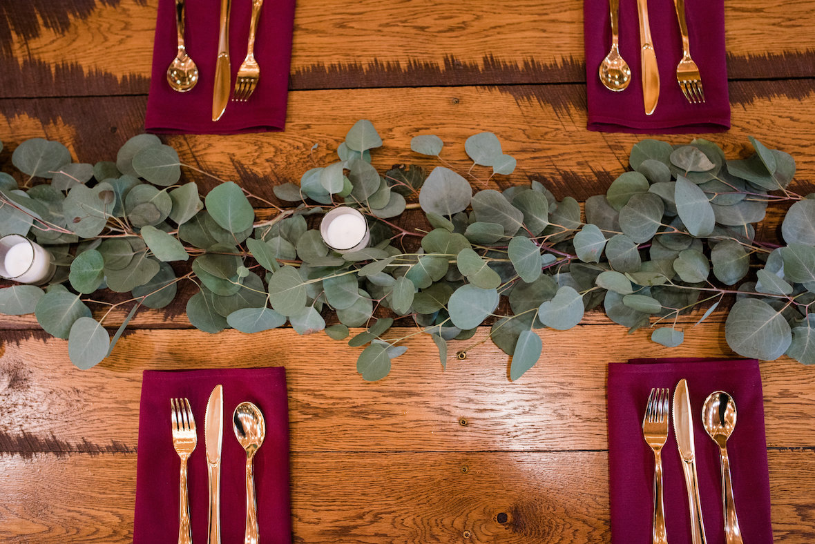 greenery-across-table-with-gold-accents.jpg