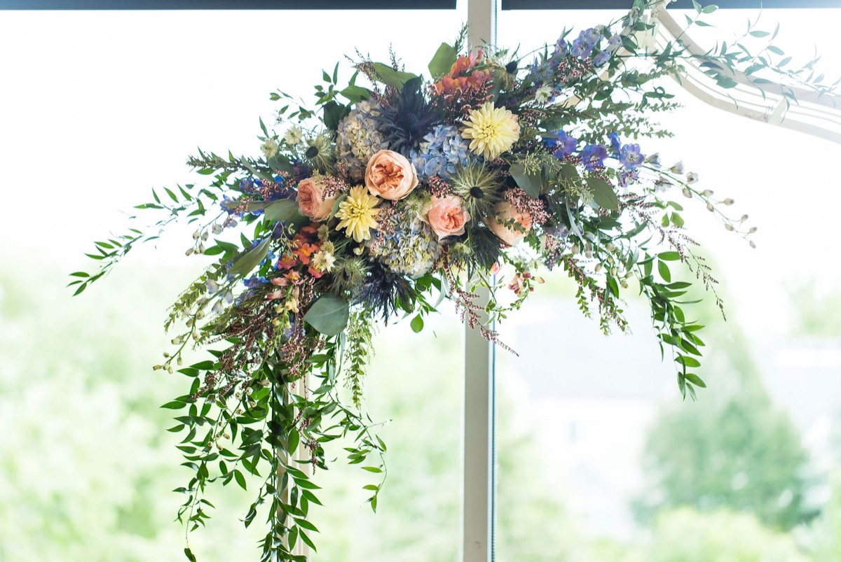 greenery_bouquet_hanging_wedding_reception_large_windows.jpg