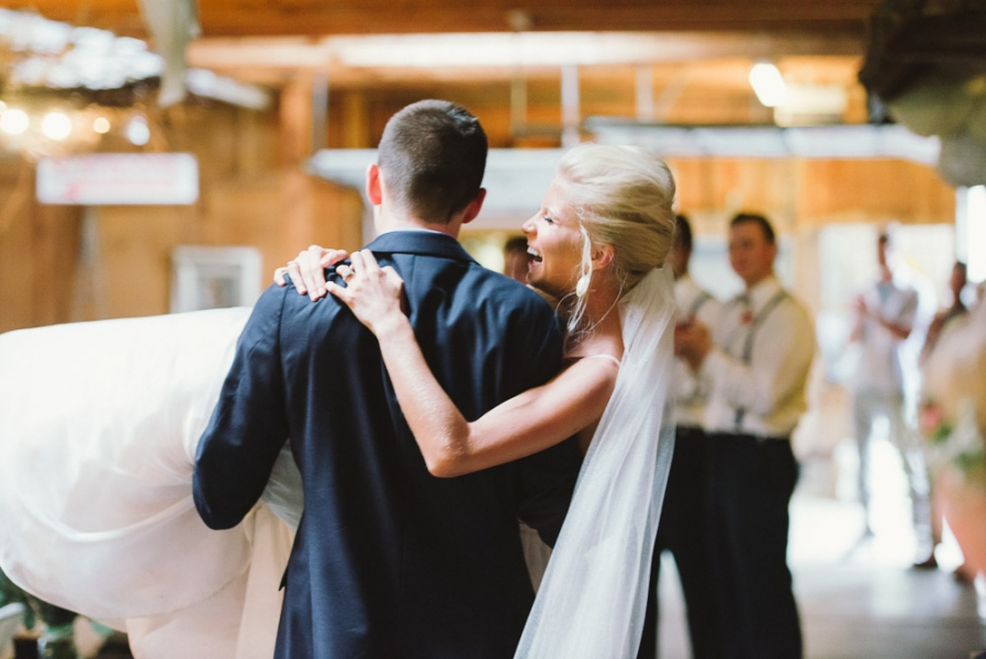 groom_carrying_bride_down_the_aisle_after_wedding.jpg