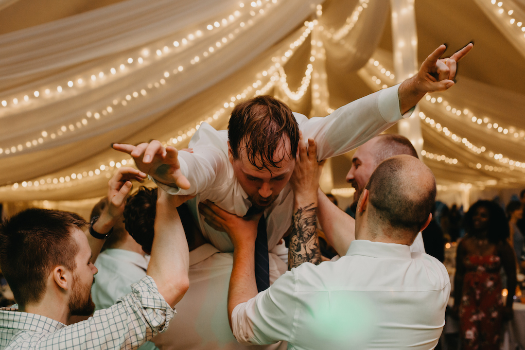groom_crowd_surfing_at_the_wedding.jpg