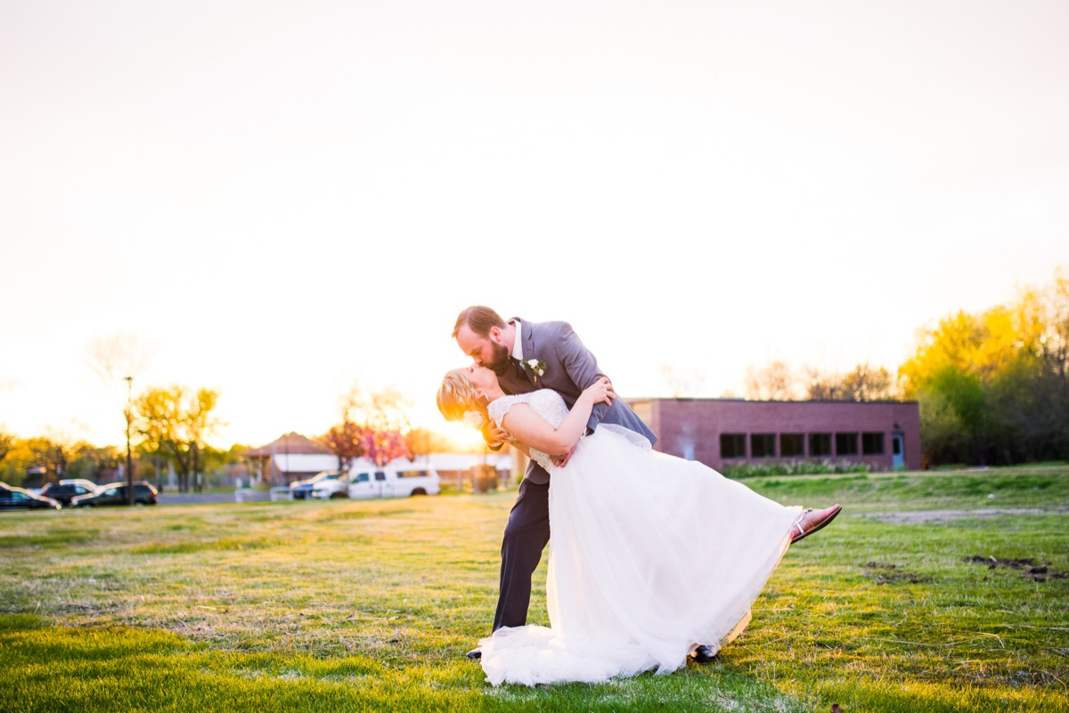 groom_dipping_bride_giving_kiss_golden_hour_pictures.jpg