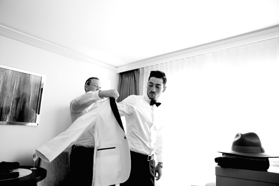 groom_getting_jacket_on.jpg