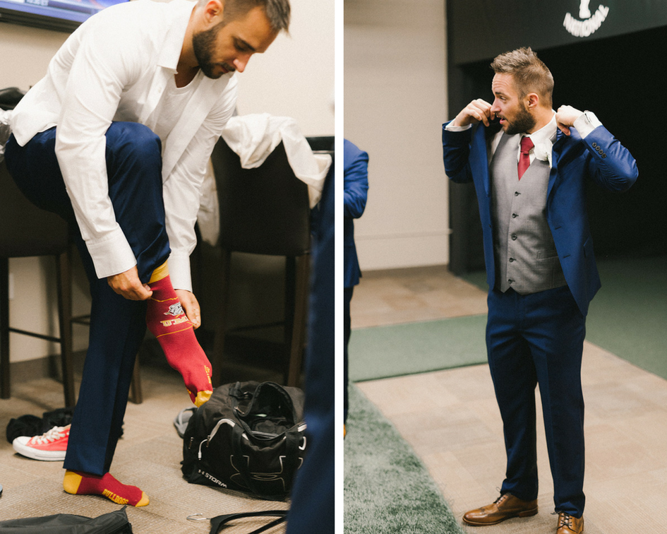 groom_getting_ready_putting_on_navy_jacket.png