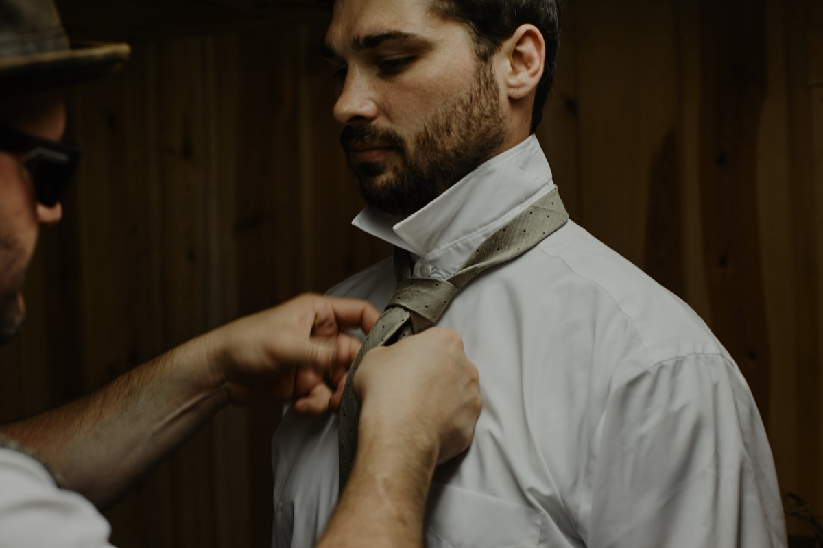 groom_getting_tan_tie_tied_barn_wedding.JPG